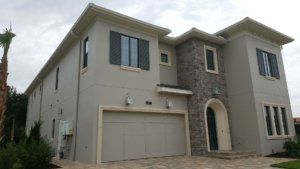 Custom home with stucco, stone veneer and precast accents - Reunion, Florida