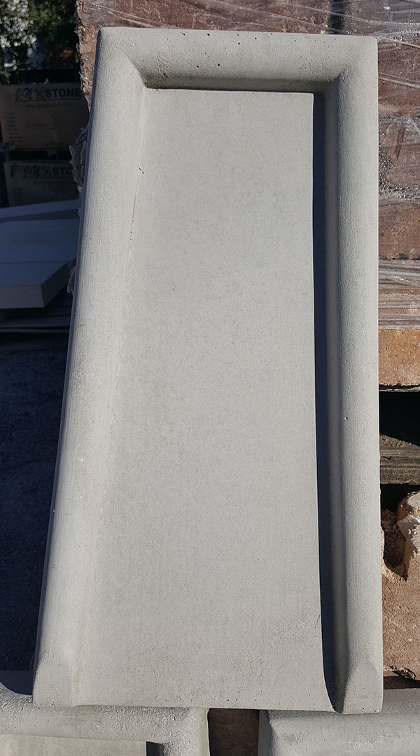 Precast stone splash block
